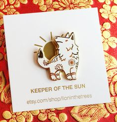 1.25-inch hard enamel pin with a butterfly clasp featuring the Keeper of the Moon and Keeper of the Sun.