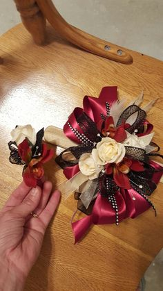 Burgundy and cream homecoming corsage set from Hen House Designs www.henhousedesigns.net