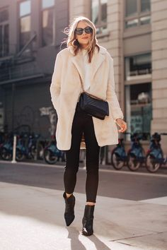 White faux fur coat (tts) white sweater black coated jeans (size down) black booties holiday outfit sweaters boots booties winter outfit New York nyc street style fashion Jackson Casual Winter Outfits, Black Coated Skinny Jeans, Black Jeans, Business Outfit Damen, Fur Coat Outfit, White Coat Outfit, White Faux Fur Coat, Leather Jeans, Leather Leggings