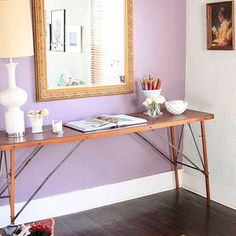 Design Sponge - entrances/foyers - Ralph Lauren - Medieval Purple - lilac, accent wall, industrial, console, table, white, lamp, gold, mirror, purple, peacock, feather, rug, runner, purple wall, purple accent wall,