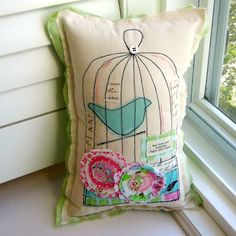 """Bird Cage Pillow- Inspiration (would make a cute quilt square) The front of the pillow features natural tone cotton with fun details: - Machine stitched birdcage design - appliqued blue birdie - hand cut appliqued flower embellishments - accent appliques of small piece of self printed """"handwritten/ script"""" fabric - applique message of """"May love and laughter light your days."""" - plump stuffed with non-allergenic poly-fil, and sewn shut. (Insert not removable. Spot clean)."""