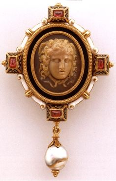 Brooch with cameo of medusa  Castellani and Sons, Rome  Gold, rubies, pearl, agate, enamel  3 7/16 x 2 1/16 x 11/16 inches  Private collection  p