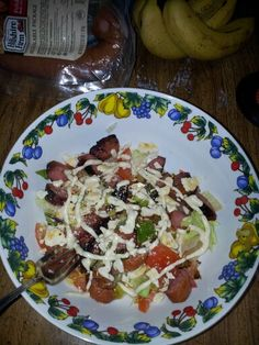 Sausage salad with fresh tomatoes and saltine crackers for texture