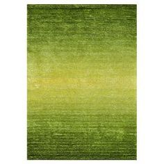 """Shag rug in green glow with an ombre design.  Product: RugConstruction Material: PolyesterColor: Green glowDimensions: 5' x 7'6"""" Note: Please be aware that actual colors may vary from those shown on your screen. Accent rugs may also not show the entire pattern that the corresponding area rugs have.Cleaning and Care: Vacuum regularly. Professional cleaning recommended."""