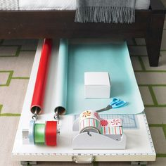 Mount your wrapping tools to a tabletop you can tuck away under the bed.