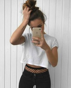 White Casual Crop Top + Black Jeans | 20+ Grunge Outfits How To Wear Fishnet Tights/Stockings Under Ripped Jeans – Lupsona