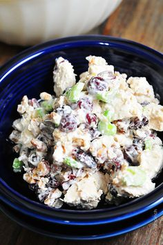 Chicken Salad with Grapes 1 pound boiled chicken, cut into ½-inch cubes  1 cup chopped celery  1 cup red grapes, halved  ½ cup dried cherries  ½ cup roasted pecans, chopped  1 cup mayonnaise  ½ teaspoon salt  ½ teaspoon ground black pepper  celery leaves, chopped (optional)