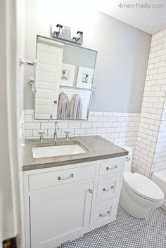 combination of subway tile and penny tile- bathroom remodel