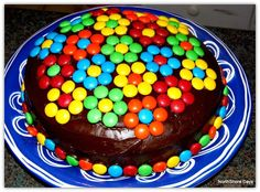 Cute idea for a cake decoration...M & M's