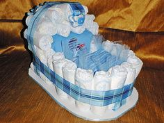 Bassinet Diaper Cake. I'd love to see this with baby detergent and wipes inside of the bassinet.