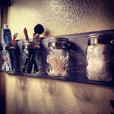 Make extra storage a statement with this mason jar bathroom caddy. | 11 Nonpermanent Design Inspirations For Personalizing Your Apartment