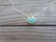 A+pretty+sea+blue+chalcedony+stone+hangs+on+a+very+pretty+chain+of+sterling+silver.+ 16+inches.+