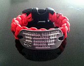 Running ID Paracord Bracelet  with Personalized Engraving. $20.00, via Etsy.