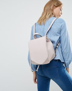 With its luxe deets (that stitching, tho...), faux-leather finish, metallic inner and baby-pink hue, no one will ever guess that your dreamy new backpack cost less than your weekly travel card