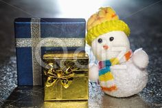 Qdiz Stock Photos | Christmas snowman toy with gift boxes or presents,  #background #beautiful #beauty #blue #bow #celebration #closeup #color #colorful #decoration #decorative #doll #figure #fun #funny #gold #golden #greeting #grunge #hat #holiday #little #metal #object #ribbon #rise #scarf #silver #small #surface #toy #traditional #white #yellow