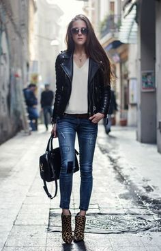 White cami, black leather jacket, distressed jeans, black bag, leopard print ankle boot heels