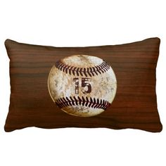 Personalized Lumbar Vintage Baseball Pillows on faux cherry wood background. Type Your Jersey NUMBER or MONOGRAM into template text box. CLICK: http://www.zazzle.com/personalized_vintage_baseball_throw_pillows_lumbar-189732963188473204?rf=238012603407381242*  Vintage baseball decor for boys bedroom and baseball man cave ideas.  ALL Vintage Baseball Gifts for Men and Boys, CLICK: http://www.Zazzle.com/YourSportsGifts* CALL Linda for Changes to Designs or HELP.