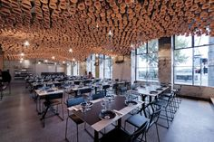 A beguiling ceiling installation made from terracotta pots hangs inside the fitout for Gazi in Melbourne | March Studio | words by Ray Edgar on ArchitectureAu
