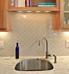 herringbone backsplash - via interiorcanvas.com