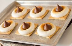 S'mores Bites in the oven.  *Can also top with Rolos instead of Hershey's Kisses.  Fun for indoor camp outs.