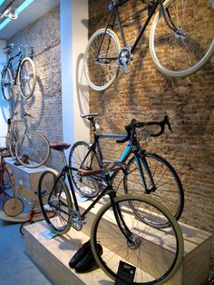 These bikes don't come cheap Bicycle Cafe, Bicycle Store, Boutique Velo, Motocross Store, Velo Design, Velo Vintage, Living Room Tv Unit Designs, Shop Interiors, Surf Shop