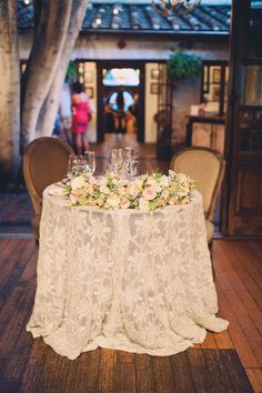 lace sweetheart table - photo by Joyeuse Photography http://ruffledblog.com/italian-villa-dinner-party-inspired-wedding