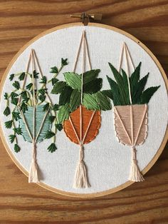 This 6 inch wooden hoop is designed and hand stitched by me here in Tasmania . This is a made to order item and ships in 7 to 14 days depending on my workload at the time if you require something before this time frame feel free to message me to discuss Im always happy to help . This piece is embroidered on quality cotton using DMC embroidery threads. Three hanging plants in lovely colours hang filled with bright textured plants . And those tassels just pop off the hoop ! All of my pieces…