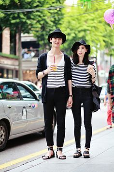 Both wearing striped shirts and black sandals. In Seoul.