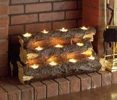 Logs with tea lights for the basement fireplace