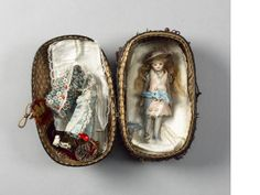 "Miniature 5"" All-bisque doll in basket, circa 1880"