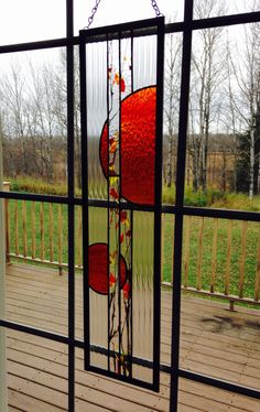 A personal favorite from my Etsy shop https://www.etsy.com/listing/488575473/orange-stained-glass-window-panel