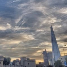 Tower and Shard and sky. Pretty. #desertedlondon #london #igerslondon #shutup_london #ilovelondon #londonpop #instagood #love #shard #towerhill by desertedlondon