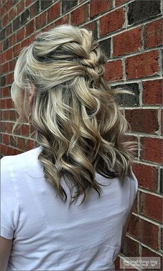 Of course, any hairstyle could be easily achieved. Here, you can create a half updo french braid (keep it a little messy for effect) and then keep the lower part curled. You will be instantly more feminine with this style.