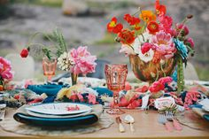 ** I absolutely love love love the bright colours and mismatching of everything on this table. Love it