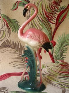 Vintage 1940s flamingo figurine - pink green black ivory. $40.00, via Etsy.