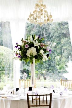 Garden Table Centerpiece designed by Lana with Fairbanks Florist.  Sterling Photography International