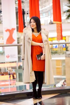 Petite fashion street style go red for women fashion show red milly dress + Karl Lagerfeld  clutch+ soft black booties+ fur cream cashmere coat