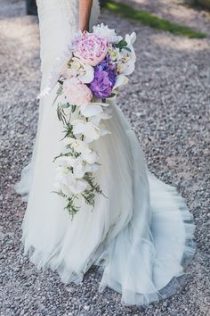 """""""The only request I gave my florist was for blue hydrangeas complemented by peonies, but I left it up to her to create something beautiful. She took my dress shape into consideration when creating the bouquet, which comprised trailing white 'Phalaenopsis' orchids, pale pink peonies, hydrangeas and eucalyptus."""""""