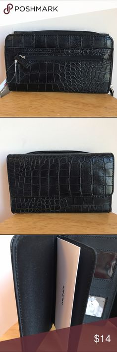Faux Snakeskin Black Clutch Wallet NWT There's plenty of space in this brand-new wallet for money, photos, credit cards, change, and a checkbook, plus many hidden pockets. NWT, by Mundi. 🦋 Dimensions: 7.75 x 5 x 1.5. Mundi by Westport Bags Wallets