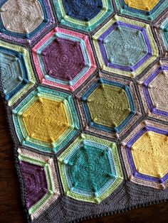 Allow me to introduce my newest FO: the Moon Landing Blanket! Features: Bold, large hexagons with color rings worked through BLO for a beautifully neat layered look Bobbled corners that…