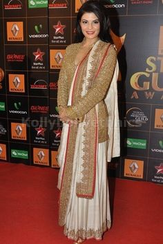 Bollywood Actress Jacqueline Fernandez Georgette Saree in Beige and Cream color