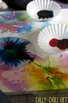 """coffee filter art. Made with Ari for his fair project, it was a blast and turned out super cute. After we dropped the food coloring and swirled, he """"accidently"""" sprayed water over and it made it way better!!!!"""