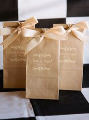 """This natural kraft favor bag was printed in ivory ink for a very organic feel.  The design is our original Barcelona from our Signature Collection. The ribbon is our 3/4"""" herringbone twill in cream and white. This ribbon is so easy to tie and makes tight crisp bows. The favor bags are available in natural kraft and white and there are 35 ink color options. www.favorsyoukeep.com"""