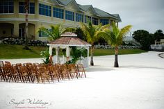 Private beach gazebo wedding at Isla Del Sol with the yacht and country club in the background. The second story windows you see in the background are where your reception will be held - wall to wall windows with breathtaking waterfront views - Isla Del Sol: Your private waterfront beach wedding and reception venue near St Pete Beach, FL!
