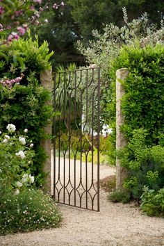 Gorgeous French country garden and iron gate.