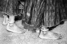 https://flic.kr/p/8j9d4Z | Your Feet | India .. 2001    fiveprime.org/blackmagic    indian peasant women were in the market on the holy day .. and i noticed their bare feet and the amazing skirts and solid anklet on their leg ..  it was mono film ..   When I cannot look at your face I look at your feet. Your feet of arched bone, your hard little feet. I know that they support you, and that your sweet weight rises upon them. Your waist and your breasts, the doubled purple of your nipples…