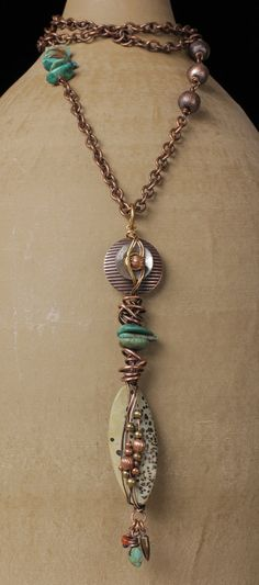Copper..this would go great with my earrings,same material...love the mixed media!!!