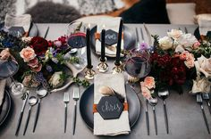 Today's autumn weddings don't have to have the season's traditional palette of oranges and browns. Instead, check out the latest in dark color schemes, with deep jewel tones, grays, and rich blues.