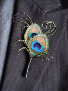 This simple elegant peacock feather boutonniere is dressed with beautiful peacock curls and a simple black satin wrap. Perfect for your peacock themed wedding or other special occasion. Can be used as a simple corsage as well. A black headed boutonniere pin will be included with each