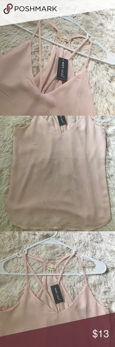 NWT Wet Seal Strappy Top Pink size XS This new with Tags Strappy Top from Wet Seal is great for showing off that summer tan! Pair it with shorts for a casual day, or dress it up with jeans and heels for a night out! This is a size extra small but can also fit a small. Wet Seal Tops Tank Tops